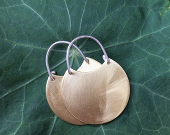 Brushed brass/ sterling silver disc earrings. Modern and elegant