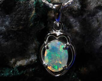 The perfect 9x7 Natural Ethiopian Faceted Opal Pendant/Necklace.