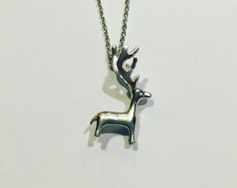 Cute tiny deer fawn pendant in silver on dainty chain