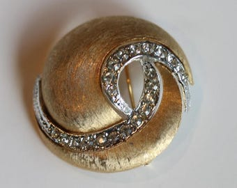 Signed J.J. vintage brushed gold tone clear rhinestone swirl pin brooch
