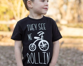 They See Me Rollin Tee