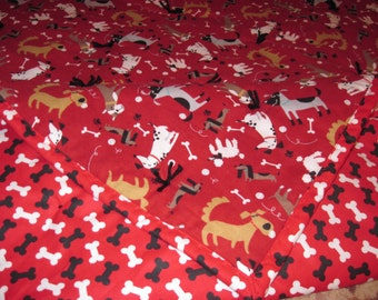 Dogs, bones and balls on a red background with black and white bones on red for a backing