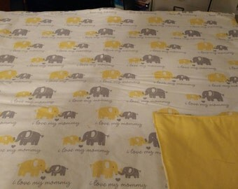 Yellow and grey elephants blanket.