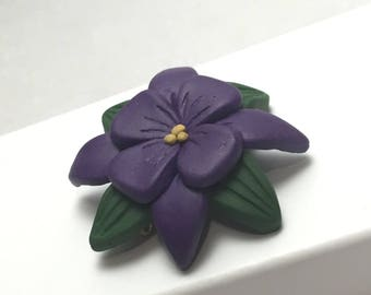 Purple Hawaiian flower pin