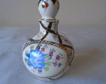 hand painted ceramic decanter floral decoration