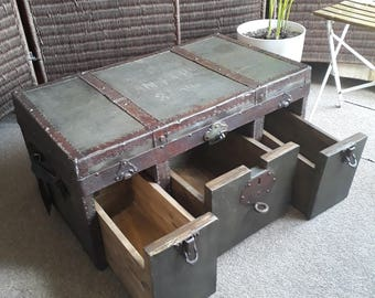 Vintage German Military trunk coffee table with 3 drawers.