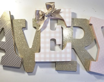 Gold and blush girls nursery letters