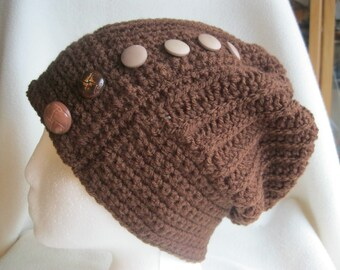 Hand crocheted slouchy autumn/winter hat in brown with button detail. To fit sizes 50-54cm.