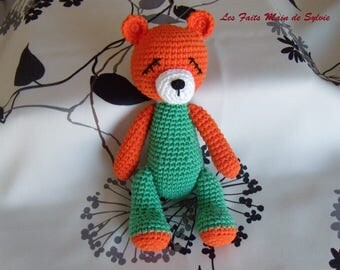 Orange and green crochet Teddy bear
