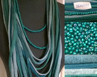 Tshirt Scarf in different green tones and one loose long green beaded necklace.