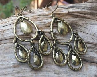 Gold dangle earrings. Bohemian earrings. Long dangle earrings. Golden earrings. Brass tone earrings. Gypsy dangles. Long teardrop dangles.