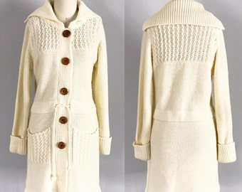 Gorgeous Vintage 1970's Cream Acrylic Knit Long Sweater with Pockets, Tie Waist, & Wooden Buttons - OSV0127