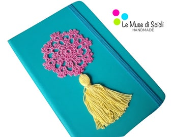 Turquoise notebook with pink and yellow crochet decoration