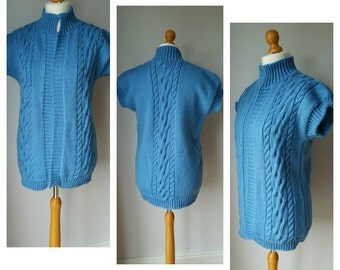 Beautiful chunky sleeveless cable cardigan