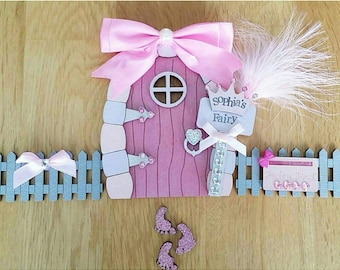 Fairy door fence and feet with feathers and bow