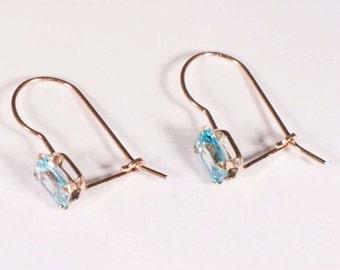 10K Yellow Gold Emerald Cut Blue Topaz Earrings