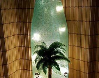 Palm tree lighted wine bottle