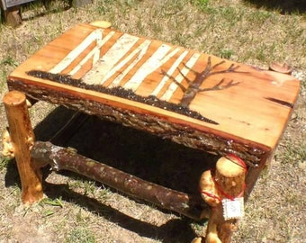 Hand carved, birch in lay, rustic coffee table.