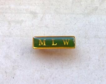 Vintage green enamel pin/M L W pin