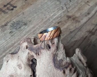 Titanium ring with olive wood