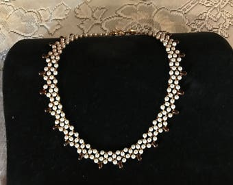 Elegant Pearl necklace with bronze color accents