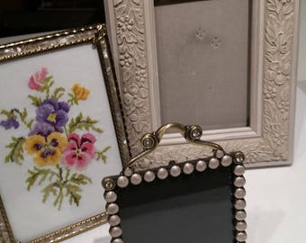 Three lovely frames, one has a nice finished pansy cross stitch in it.