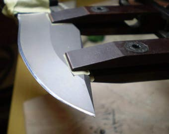 SHARPENING KNIVES on a grinding STONE. Sharpening a knife after manufacture in the forge.