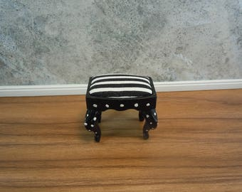 Dollhouse Miniature furniture in twelfth scale or 1:12 scale.  Footstool, black with black and white striped fabric.  Item #318.
