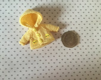 Dolls house Miniature 1/12th knitted baby doll lemon rain jacket