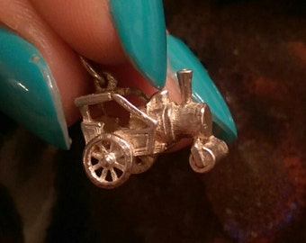 Antique steam roller tractor vintage sterling charm or pendant
