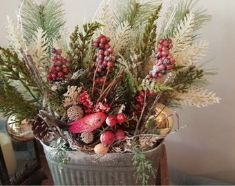Winter Nesting is a winter country chic design in oval container with bird in nest, gold balls and frosty branches