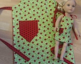 Child's ladybug apron with matching doll apron