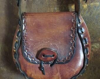 Pretty vintage little chunky tooled shoulder bag.