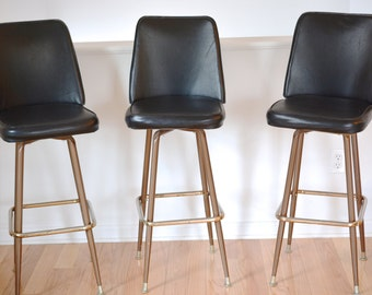 Bar stools, swivel, black, brass, midcentury, armless, set of three