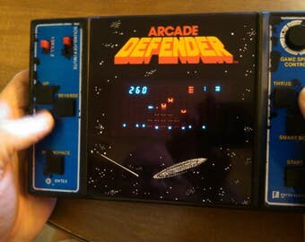 Arcade Defender -- 1981 Entex Hand-held Video Game -- Works