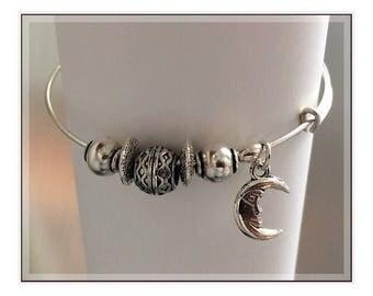 B0011  Mr. Moonlight Silver bangle/charm bracelet.