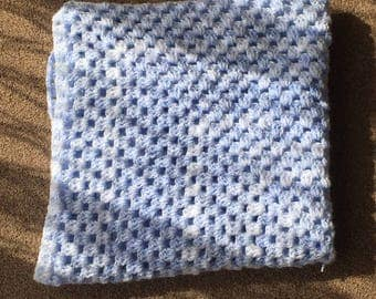 Beautiful baby blue crocheted baby blanket.