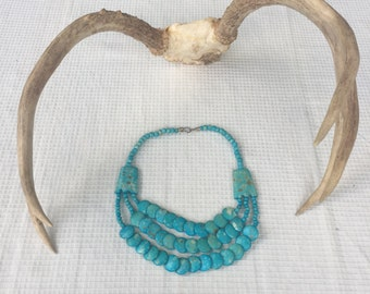Turquoise stone necklace.