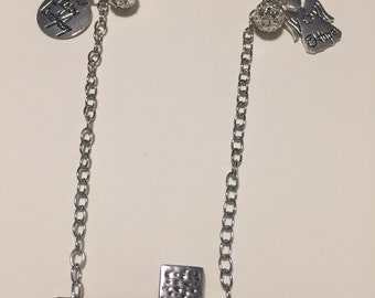 silver tone chain with cross and charms