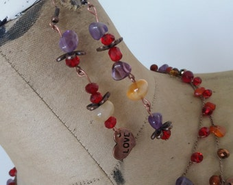 Different but similar earrings, Carnelian and Amethyst crystals