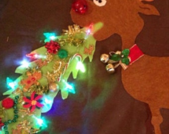 Ugly Christmas sweater barfing reindeer on front and pooping reindeer on back lights up ..hilarious original design.