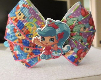 Shopkins bow on a blue hard headband