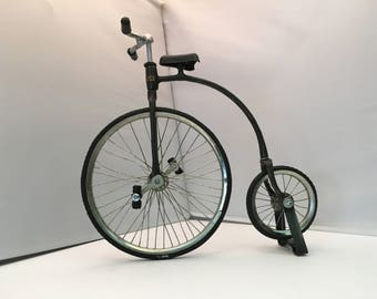 Miniature reproduction of the bicycle's wheel high, created in 1870 in France, made by hand, measures 22 cm. X 25cm.