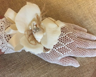 Wrist Corsages made with sea shell on silk pedals and embellished with pearls, rhinestones and jute - ribbon or covered elastic band.