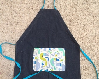 Small kids apron, lightweight denim with toucan fabric pocket