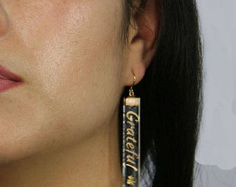 """When the word """"Grateful"""" says it all! These are very light and unique hand painted 24 karat Gold on clear glass earrings."""