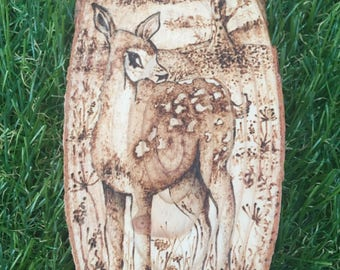 Decorative Wooden Slice with Had-drawn Pyrography image of Deer in the forest.