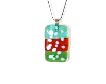 Red, blue and green fused glass pendant with white dots