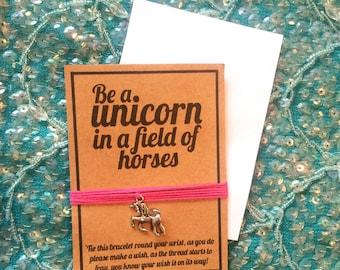 Unicorn in a field of horses wish charm friendship bracelet