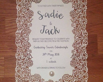 Laser cut rose themed wedding invitations wedding stationery